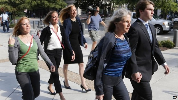Former Virginia first lady Maureen McDonnell, second from right, holds hands with her son Bobby McDonnell, right, as they arrive at federal court followed by daughter Cailin Young, left, Rachel McDonnell, second form right, and attorney Heather Martin, center, in Richmond, Virgina 28 August 2014