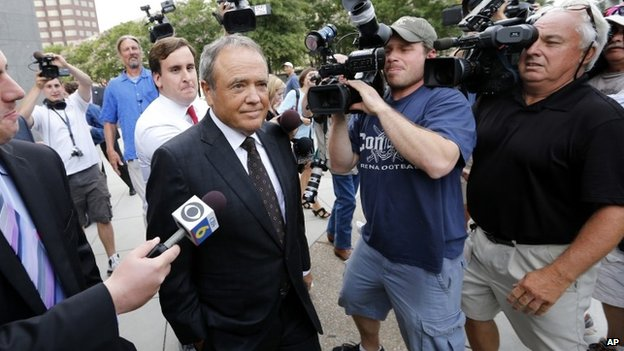 Surrounded by reporters, former Star Scientific CEO Jonnie Williams leaves federal courthouse in Richmond, Va., after testifying 31 July 2014