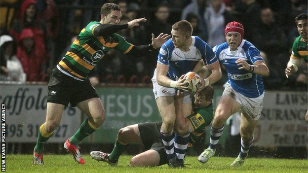Jack Dixon of Newport Gwent Dragons is tackled by George North and Dylan Hartley of Northampton Saints