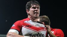 Louie McCarthy-Scarsbrook celebrates his try for St Helens at Headingley