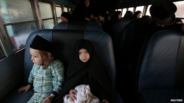 Lev Tahor members prepare to leave San Juan La Laguna on a bus
