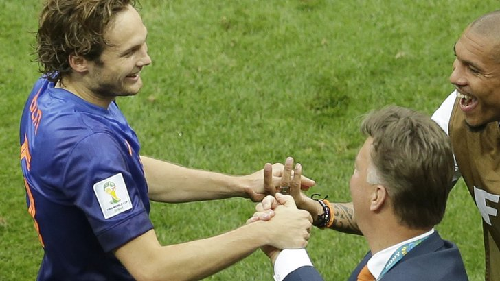 Daley Blind and Louis Van Gaal shake hands at the 2014 World Cup
