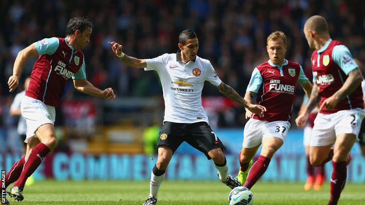 Angel Di Maria fights for the ball against Burnley