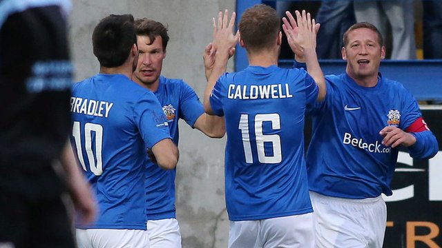 Glenavon players celebrate victory over Ballymena United