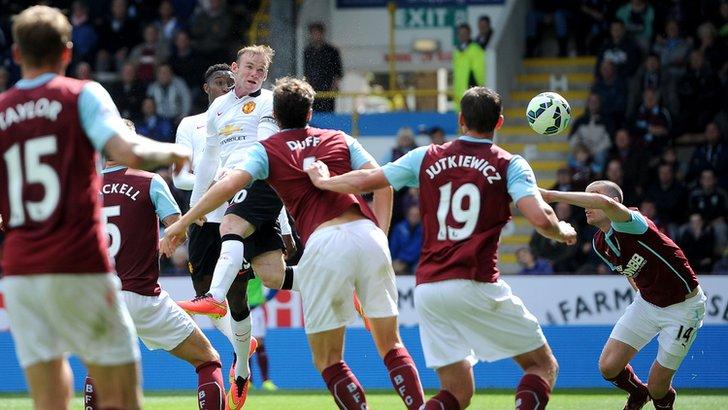 Wayne Rooney heads towards goal