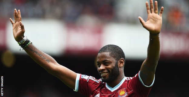 Alex Song acknowledges fans at the Boleyn Ground