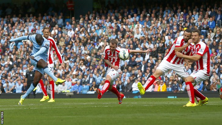 Ya Ya Toure takes a shot for Manchester City