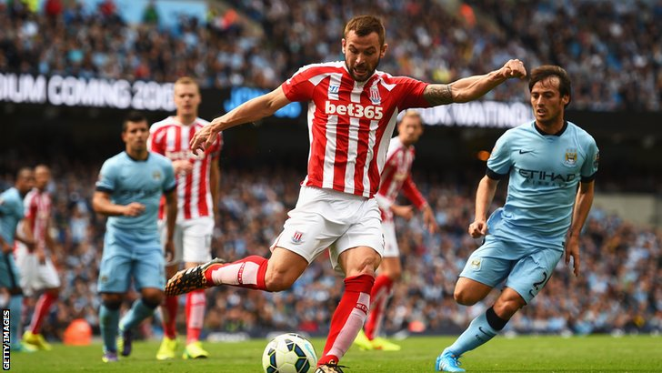 Phil Bardsley clears for Stoke City against Manchester City