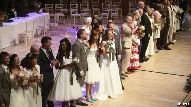 Couples after being married in a mass ceremony at the Royal Festival Hall