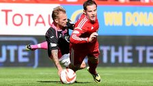 Aberdeen's Peter Pawlett goes down under a challenge from Kallum Higginbotham