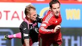 Aberdeen's Peter Pawlett goes down under a challenge from Kallum Higginbotham