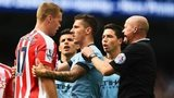 Ryan Shawcross clashes with Edin Dzeko