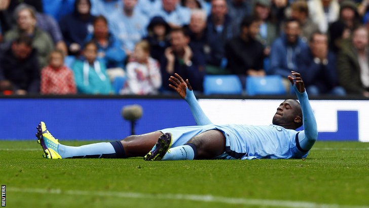 Yaya Toure lies on the ground after being denied a penalty