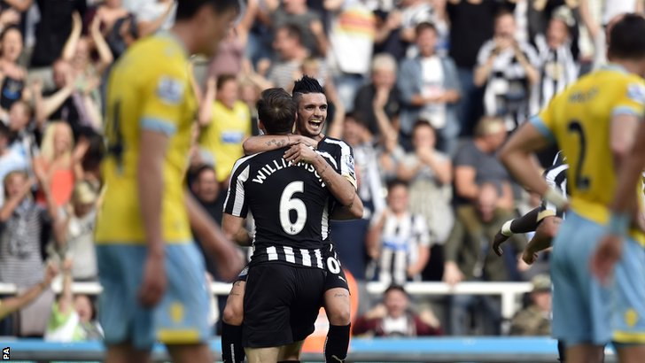 Mike Williamson celebrates after scoring Newcastle's third goal