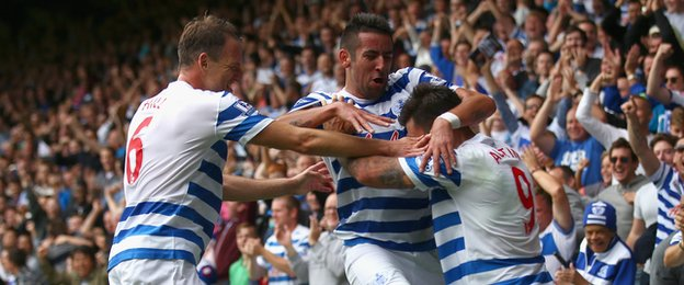 QPR players celebrate Charlie Austin's goal