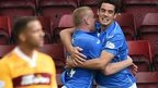 St Johnstone's Brian Graham (right) celebrates with teammate Brian Easton after scoring on his debut