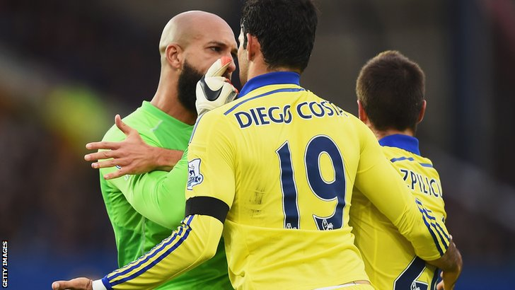 Tim Howard is booked after arguing with Diego Costa and Cesar Azpilicueta