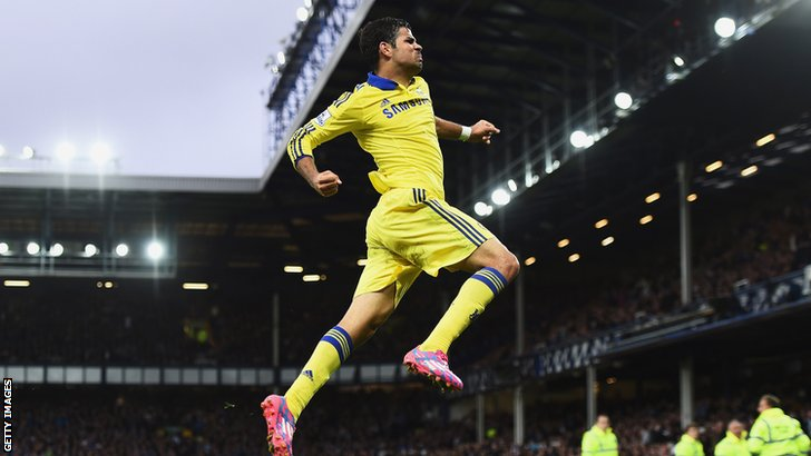 Diego Costa jumps to celebrate his goal as Chelsea go 6-3 ahead against Everton