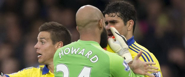 Diego Costa is confronted by Everton keeper Tim Howard