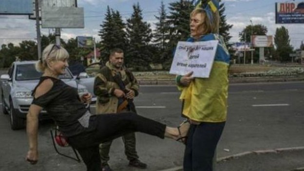 Iryna Dovgan is being kicked by a woman in Donetsk