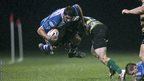 Cory Hill is tackled by Northampton's Howard Packman during Dragons' 27-25 friendly win at Ebbw Vale.