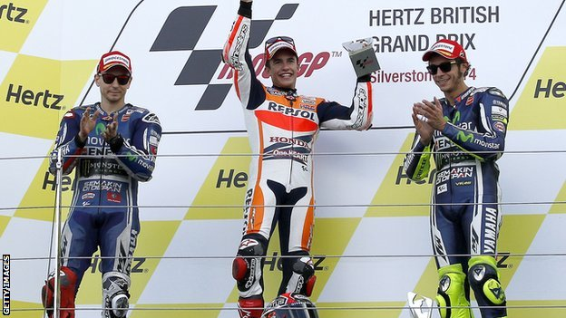 Marc Marquez (centre) flanked by Jorge  Lorenzo (left) and Valentino Rossi
