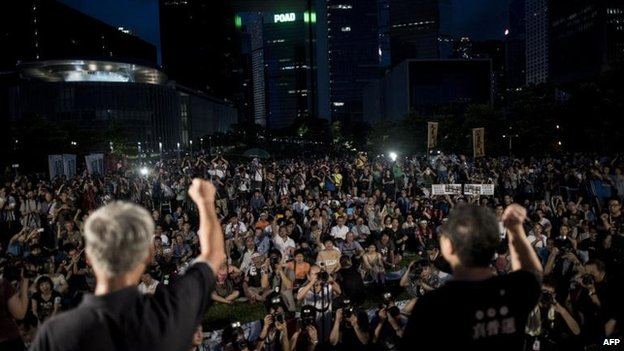 Benny Tai (R) rallies the democracy supporters, 31 Aug