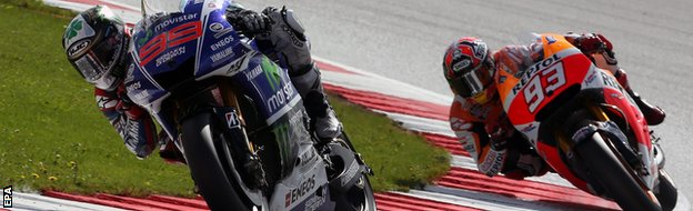 Lorenzo (left) and Marquez tussle for the lead
