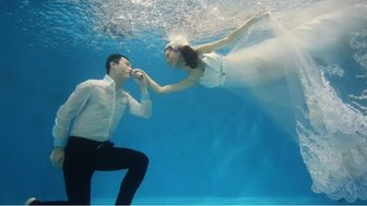 Bride and groom-to-be photographed underwater