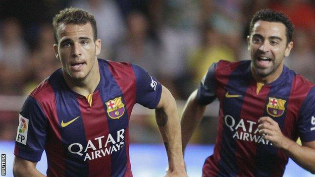 Barcelona's Sandro Ramirez (left) celebrates next to team mate Xavi Hernandez
