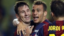 Barcelona's Sandro (center) is congratulated by teammate Lionel Messi