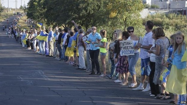 Residents of Mariupol form a human chain to protest against Russia's actions, 30 Aug