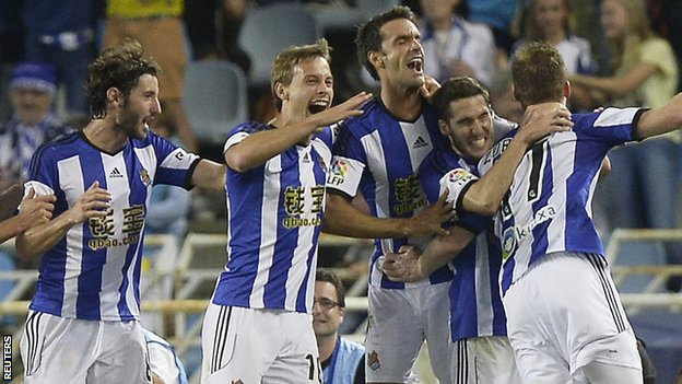 The Real Sociedad players celebrate a David Zurutuza goal