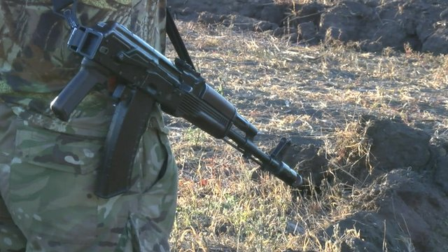 Ukrainian man with a gun in Mariupol