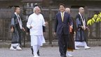 India's Prime Minister Narendra Modi (front L) and his Japanese counterpart Shinzo Abe smile during their visit to Toji Buddhist temple in Kyoto on 31 August 2014