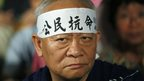 "A protester wears a headband with Chinese characters ""Citizen disobedience"" during a rally after China's legislature ruled out allowing open nominations in inaugural elections for Hong Kong's leader in Hong Kong on 31 August 2014"