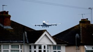 A plane flying over houses into Heathrow