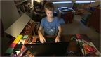 A boy on a computer