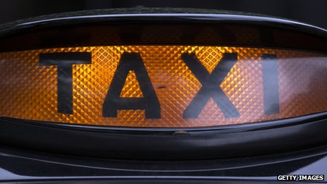 Black cab taxi sign