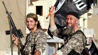 Islamic State fighters parade in Raqqa, Syria (30 June 2014)
