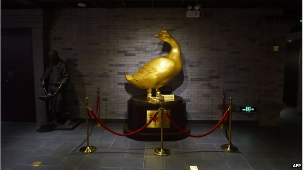 This photo taken on 24 July 2014 shows a golden duck in the museum at the Quanjude restaurant in Beijing