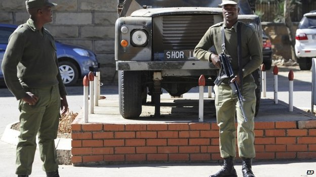 Army personnel man outside the military headquarters in Maseru, Lesotho on 31 August 2014.