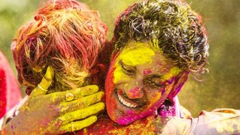 Young Indian people celebrate the Hindu festival of Holi by throwing coloured powder called Gulal at each other