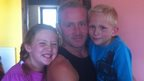 Matthew Thompson with his children