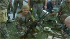 Pro-Russian separatist holding a weapon