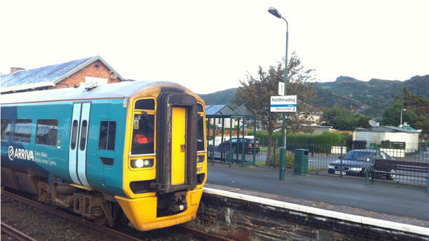 Train arrives in Porthmadog station on Cambrian Coast line