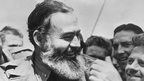 Ernest Hemingway, as war correspondent, travelling with US soldiers to Normandy for the D-Day landings