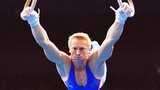 Craig Heap of Great Britain in action on the Rings in the Men's Gymnastics Individual All-Around Final at the Sydney 2000 Olympic Games