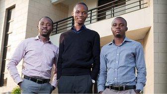 Ayodeji Adewunmi, Olalekan Olude and Opeyemi Awoyemi standing outside in business attire