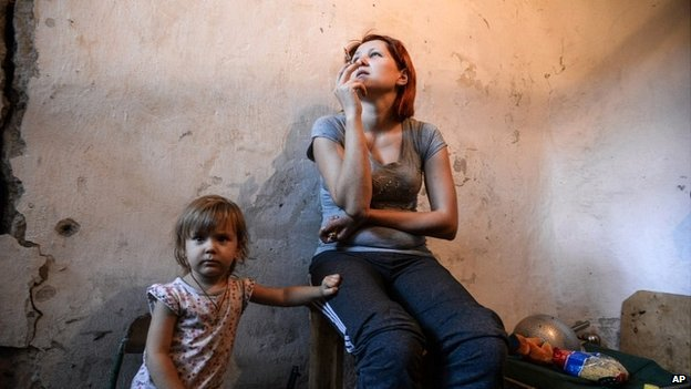 A mother and child hide in a bomb shelter in Petrovskiy district in Donetsk, eastern Ukraine - 1 September 2014